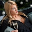 Portrait of blond sexy woman with champagne on Christmas — Stock Photo
