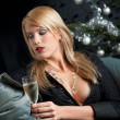 Blond woman with glass of champagne on Christmas — Stock Photo #4696134