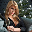 Portrait of blond sexy woman with champagne on Christmas — Stock Photo #4696136