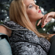 Provocative woman posing in front of Christmas tree — Stock Photo
