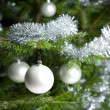 Silver decorated Christmas tree with balls and chains - Stock Photo