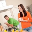 Young woman having coffee in the kitchen — Stock Photo