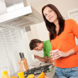 Young woman having coffee in the kitchen — Foto de Stock
