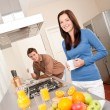Royalty-Free Stock Photo: Smiling woman and man in the kitchen