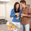 Stock Photo: Young woman and man in the kitchen