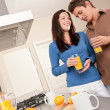 Young man and woman drinking orange juice — Stock Photo #4696243