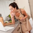Woman with laptop in the kitchen — Stock Photo