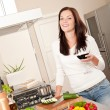 Young woman with glass of red wine in the kitchen — Stock Photo #4696333