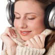 Portrait of happy woman enjoying music with headphones — Стоковая фотография