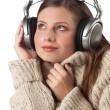 Portrait of happy woman enjoying music with headphones — Stockfoto