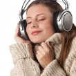 Portrait of happy woman enjoying music with headphones — Stock Photo #4696391