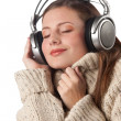 Stock Photo: Portrait of happy woman enjoying music with headphones