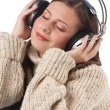 Portrait of happy woman enjoying music with headphones — Stock Photo #4696393
