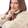 Portrait of beautiful young woman wearing turtleneck — Stock Photo