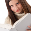 Portrait of young happy woman with book wearing turtleneck — Stock Photo