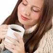 Winter portrait of happy woman holding cup of coffee — Stock Photo
