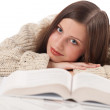 Portrait of young happy woman with book — Stock Photo