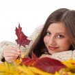 Autumn portrait of beautiful woman with leaf wearing turtleneck — Stock Photo #4696493