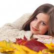 Autumn portrait of beautiful woman with leaf wearing turtleneck — Stock Photo #4696495
