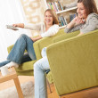 Stock Photo: Students - Two female student relaxing home