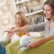 Stock Photo: Students - Two smiling female teenager watching television