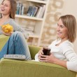 Stock Photo: Students - Two smiling female teenager watching television toget