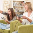 Students - Two female teenager playing video TV game — Stock Photo
