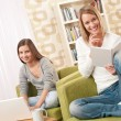 Students - Two teenage girls with laptop and book — Stock Photo