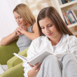 Students - Two female students studying in lounge — Stock Photo