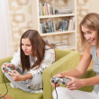 Stock Photo: Students - Two female teenager playing video TV game