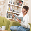Students - Happy teenager with book sitting on armchair — Stok fotoğraf