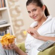 Stock Photo: Students - Happy female teenager with potato chips