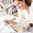 Stock Photo: Young female interior designer working at office