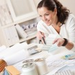 Foto Stock: Female interior designer working at office