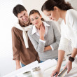Female interior designer with two clients at office — Stock Photo #4698443