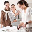 Female interior designer with two clients at office — Stock Photo #4698445
