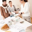 Female interior designer with two clients at office — Stock Photo #4698446