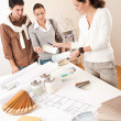 Foto Stock: Female interior designer with two clients at office