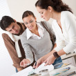 Female interior designer with two clients at office — Stock Photo #4698448