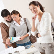Female interior designer with two clients at office - Stock Photo
