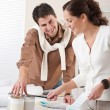 Two interior designer working at office with color swatch — Stock Photo #4698454