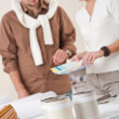 Two interior designer working at office with color swatch — Stock Photo #4698456