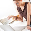Smiling female designer with color swatch — Stock Photo