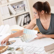 Female interior designer working with color swatch — Stock Photo