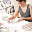 Female interior designer working with color swatch — Stock Photo #4698528