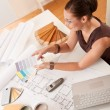 Female interior designer with color swatches - Stock Photo