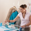 Royalty-Free Stock Photo: Female fashion designer working at studio