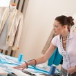 Female fashion designer working at studio — Stock Photo