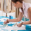 Professional tailor working with fashion sketches — Stock Photo