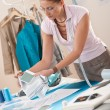 Female fashion designer working at studio - Foto Stock
